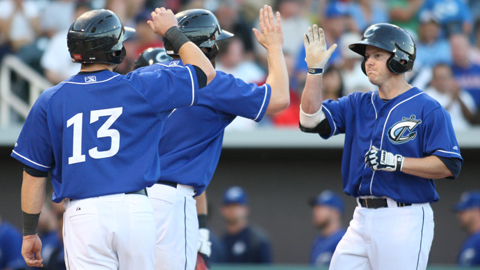 Luke Carlin is congratulated after homering to erase the Clippers' early three-run deficit.